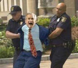 bush in cuffs